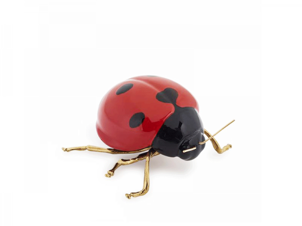 Red ladybird with brass legs